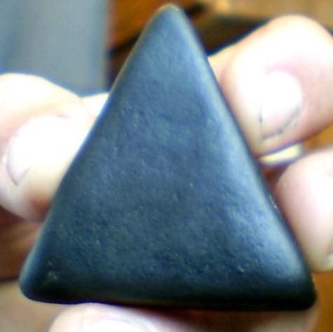 Smooth Triangular Black Rock Found Near Burial